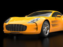 Yellow sports car - front view closeup shot - ground reflection. Isolated on black background Stock Photos