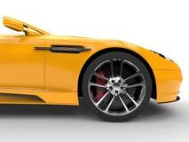 Yellow sports car - front wheel Stock Photos