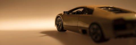 Yellow sports car illuminated. With dark background Stock Photos