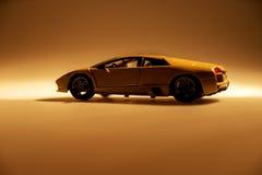 Yellow sports car illuminated. With dark background Royalty Free Stock Photo