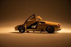 Yellow sports car illuminated. With dark background Stock Photo