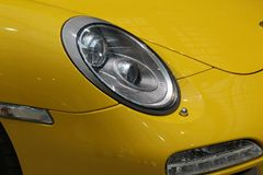 Yellow sports car. Headlight from the yellow car. Yellow sports car. Machine - vehicle. Headlight from the yellow car. Design. Cover, magazines, car blogs royalty free stock photo