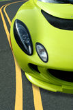 Yellow Sports Car On The Road Royalty Free Stock Photos