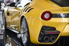 Yellow sports car. Rear view Royalty Free Stock Photos