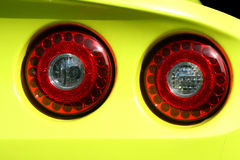 Yellow sports car red tail lights. A Yellow sports car red tail lights Royalty Free Stock Image