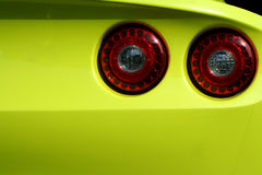 Yellow sports car red tail lights Royalty Free Stock Images