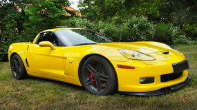 Sports Car, New American Muscle Cars. Yellow sports muscle car - Chevrolet Corvette C 6. New American muscle cars stock photos