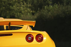 Yellow sportscar. Brakelight and spoiler with blurry background stock photos