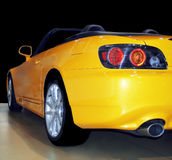Yellow Sportscar. Yellow convertible sportscar from the back end Royalty Free Stock Photography