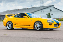 Yellow sporty Toyota Supra A80 Stock Photography