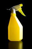 Yellow spray bottle Stock Images