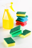 Yellow spray bottle and multicolored sponges Stock Images