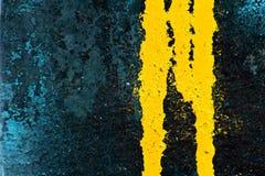 Yellow spray paint leak Stock Images