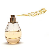 Yellow Spraying Parfume on White Background. Photomanipulation of smoke and parfume bottle depicting spraying golden scent royalty free stock photos
