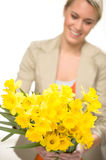 Yellow spring narcissus woman in background Royalty Free Stock Photography