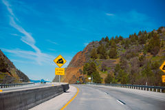 Yellow square warning information Road sign downhill to pass on Royalty Free Stock Image