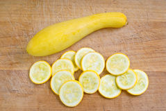 Yellow Squash. Yellow summer squash whole and sliced on cutting board Royalty Free Stock Photography