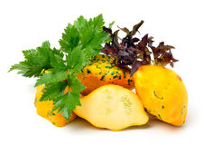 Yellow Squash Pattypan with different lettuce, water-cress, spin Royalty Free Stock Images