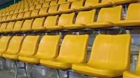 Yellow stadium seats zooming stock video footage