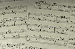 Yellow stained music sheets stock images