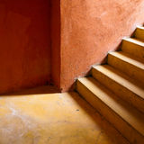Yellow Stair And Orange Wall Royalty Free Stock Images
