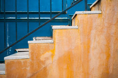 Yellow stair and contrast blue wall Stock Photography