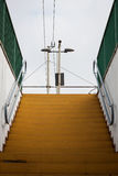 Yellow stair of a railroad station. With grey sky on background Stock Image