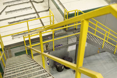 Yellow stairs. Yellow emergancy exit staircase in a factory royalty free stock images