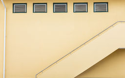 Yellow Stairs Under Vents Royalty Free Stock Photo