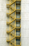 Yellow stairways. Exterior metal yellow stairways on concrete facade stock images