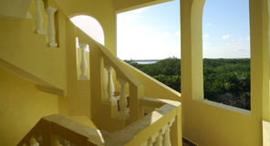 Yellow stairwell with view of the mexican jungle Royalty Free Stock Photo