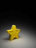 Yellow star on dark background Royalty Free Stock Photography
