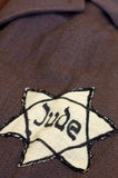 Yellow star of David on his coat Royalty Free Stock Images