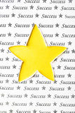 Yellow star shape and paper texture, success conception Royalty Free Stock Photography