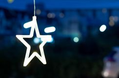 The yellow star-shaped lights for decoration. royalty free stock photography