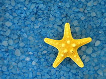 Yellow starfish and bath salt Royalty Free Stock Images