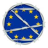 Yellow stars on blue background symbol of European Union behind barbed wire. Migration problem Royalty Free Stock Photo