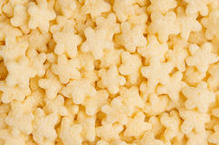 Yellow stars corn flakes closeup background, cereals texture. Top view. Stock Photography