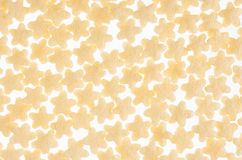 Yellow stars corn flakes closeup on white background, cereals texture. Top view. Royalty Free Stock Photos