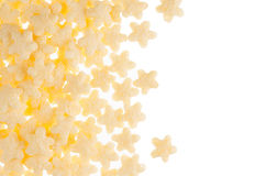 Yellow stars corn flakes isolated on white background with copy space. Stock Photo