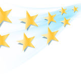 Yellow stars flowing over blue wavy folding background Stock Photo