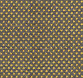 Yellow stars pattern on fabric Royalty Free Stock Photo