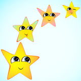 Yellow stars with smiling faces, eyes, mouth and brushes. Stock Images