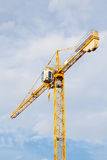 Yellow stationary hoist crane Stock Photos