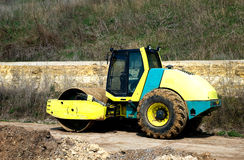 Yellow steamroller. Road construction equipment, in anticipation Royalty Free Stock Image