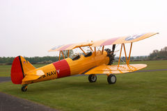 Yellow stearman biplane Stock Photo