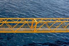 Yellow Steel Bridge Across Blue Water Stock Photography