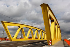 Yellow steel bridge, cloudy sky Royalty Free Stock Image