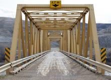 Yellow steel bridge on road Royalty Free Stock Photos