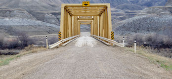 Yellow steel bridge on road Stock Photos